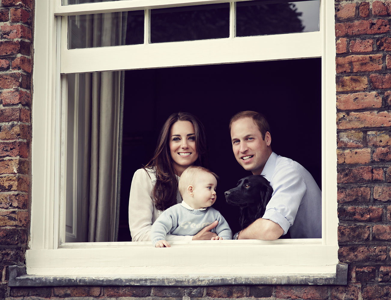 The Duke and Duchess of Cambridge with their son Prince George, photographed at Kensington Palace, March 2014.
