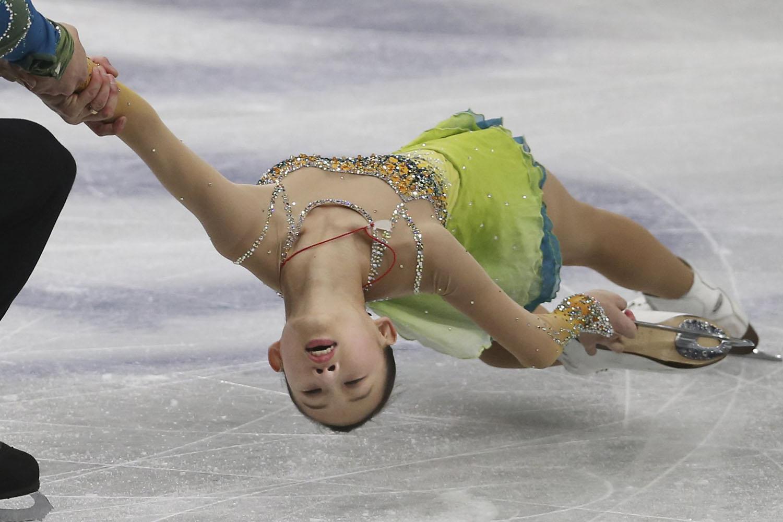 Mar. 26, 2014. Peng Cheng and Zhang Hao of China perform their pairs free skating in the World Figure Skating Championships in Saitama, near Tokyo.