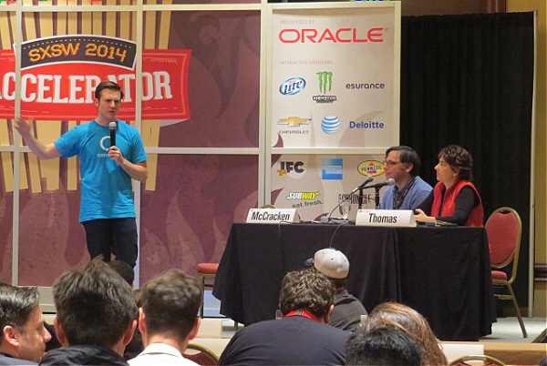 Ryan Allis, CEO of Connect, pitches at the SXSW Accelerator as emcees Harry McCracken and Maria Thomas observe