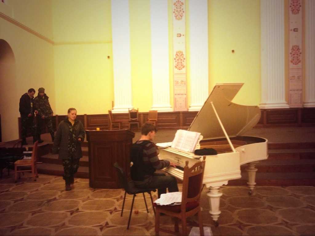 An activist wearing a bulletproof vest plays piano at Kiev's city hall, March 6, 2014.