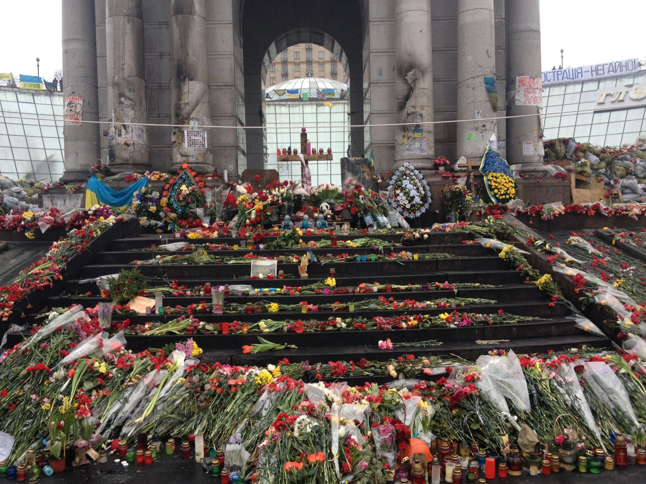 Flowers memorialize the dead at the square's independence monument. March 6, 2014.