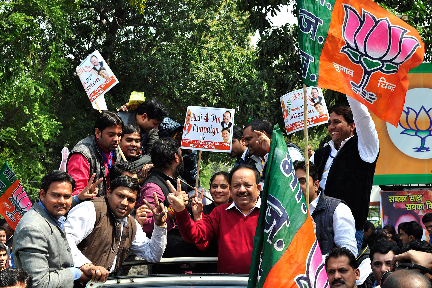 BJP Delhi president Harsh Vardhan launches a rally promoting Narendra Modi as the prime-ministerial candidate at the forthcoming Lok Sabha elections at the BJP office in New Delhi on March 4, 2014