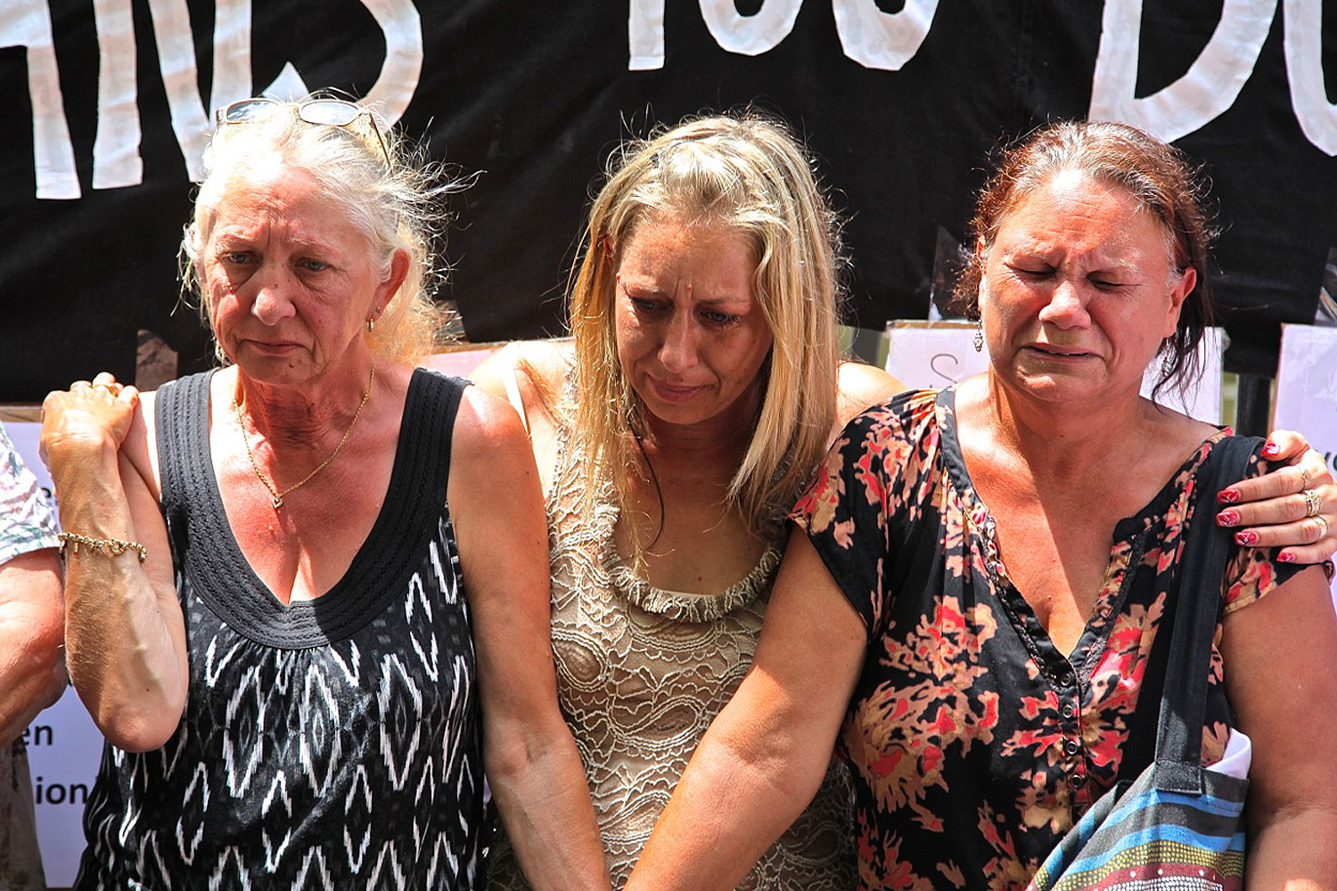 Members of Grandmothers Against Removals protesting against the overrepresentation of indigenous children in the child-protection system on the steps of the parliament house of New South Wales in Sydney on Feb. 13, 2014