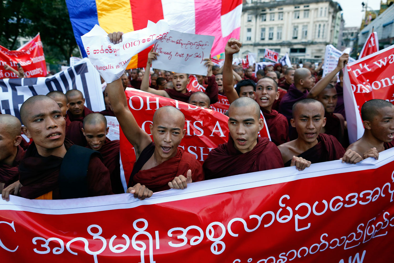 Buddhist monks protest against a visit to Myanmar by a high-level delegation from the Organization of Islamic Cooperation (OIC), in Yangon in November  2013. The clergy play a leading role in stoking anti-Muslim feeling.
