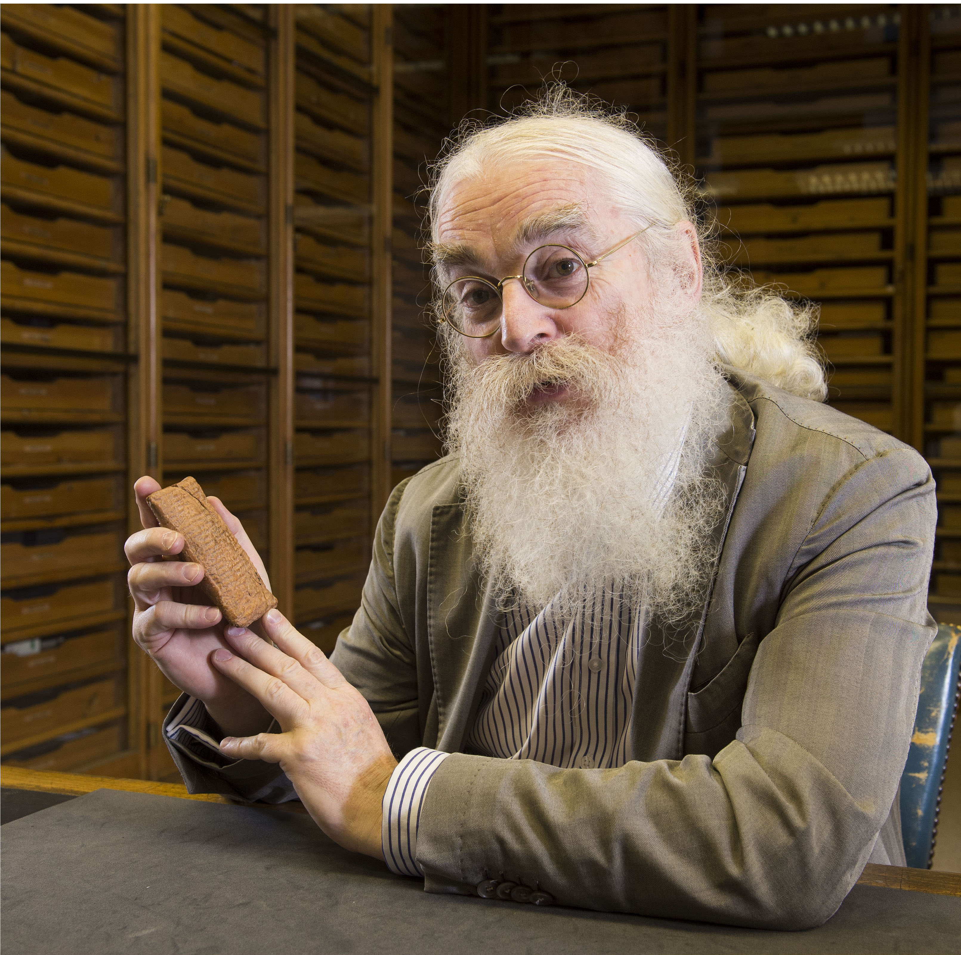 Irving Finkel with the Ark Tablet