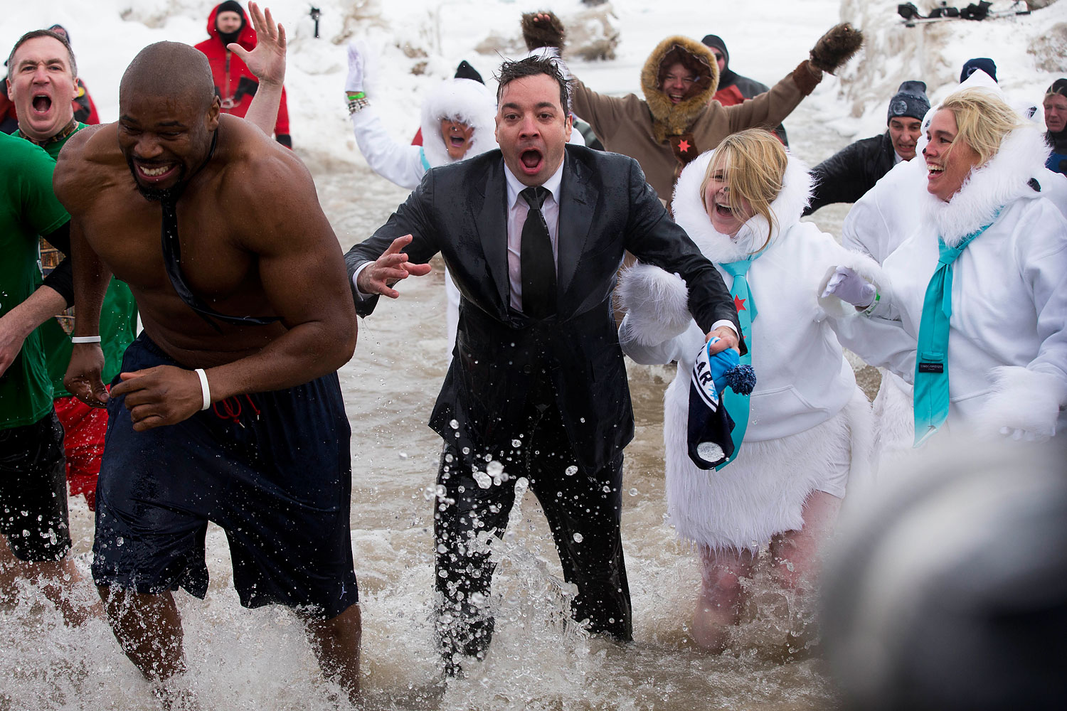 The Tonight Show  host Jimmy Fallon, center, exits the water during the Chicago Polar Plunge, Sunday, March 2, 2014, in Chicago. Fallon joined Chicago Mayor Rahm Emanuel in the event.