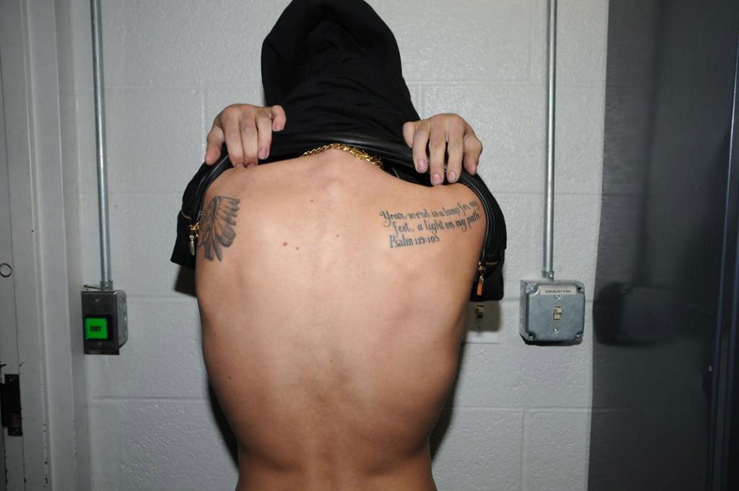 In this handout photo provided by the Miami Beach Police Department and released on March 4, 2014, singer Justin Bieber displays his tattoos for police documentation while in custody on January 23, 2014 in Miami Beach, Florida.