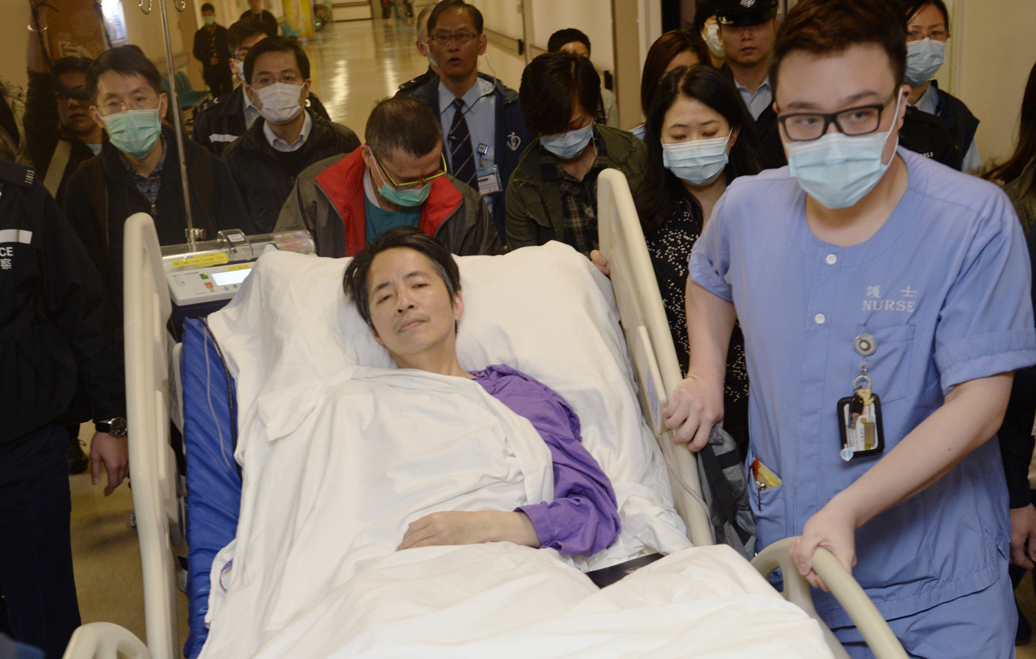 Ming Pao's former chief editor Kevin Lau, who was brutally attacked on Wednesday, is transferred to a private ward in Eastern Hospital after spending three days in intensive care in Hong Kong March 1, 2014.