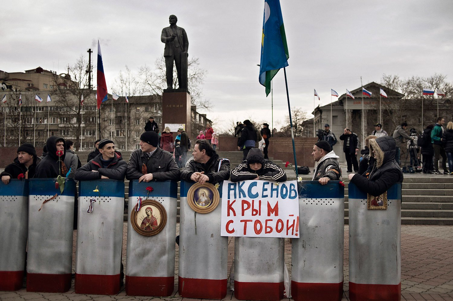 Members of a pro-Russian group stationed themselves in front of government buildings and a statue of Lenin in Simferopol on Sunday.