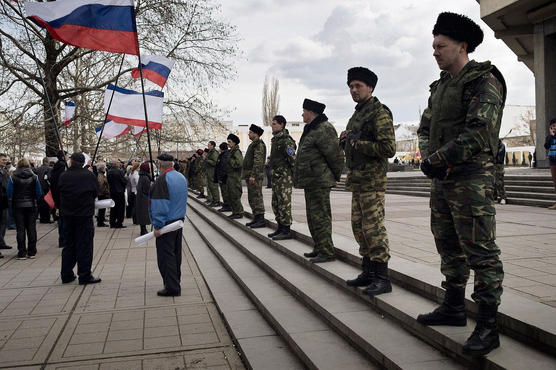 Cossacks guard the local parliament building in Crimea's capital Simferopol on March 6, 2014