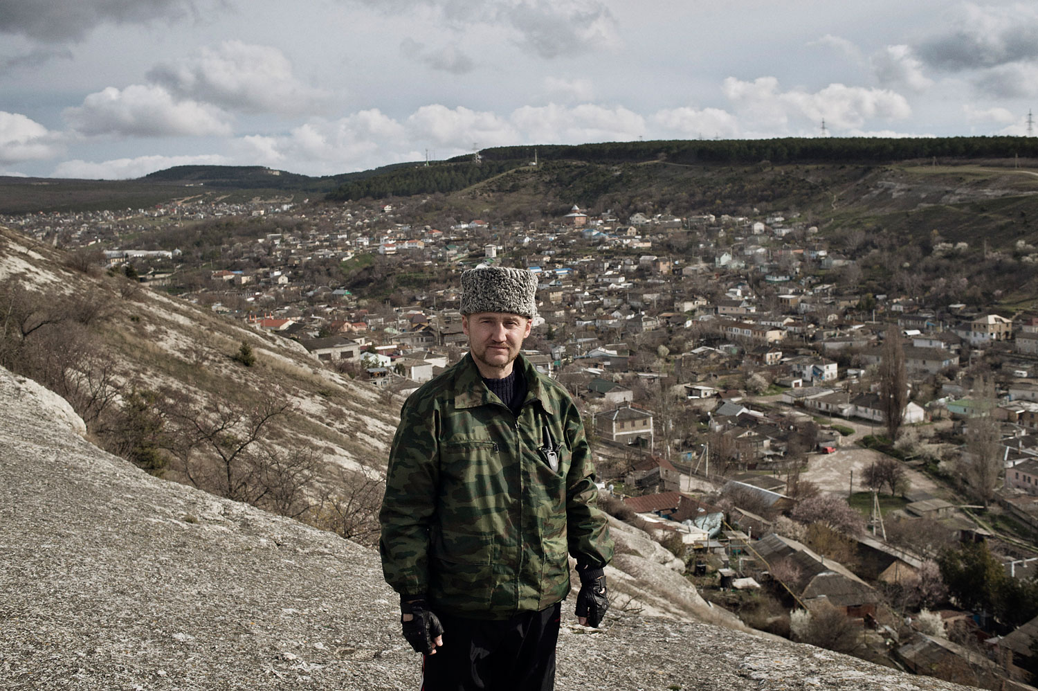 Sergei Yurchenko, the leader of a pro-Russian paramilitary force in Crimea, stands at a lookout point over his hometown Bakhchysarai, on March 16, 2014.
