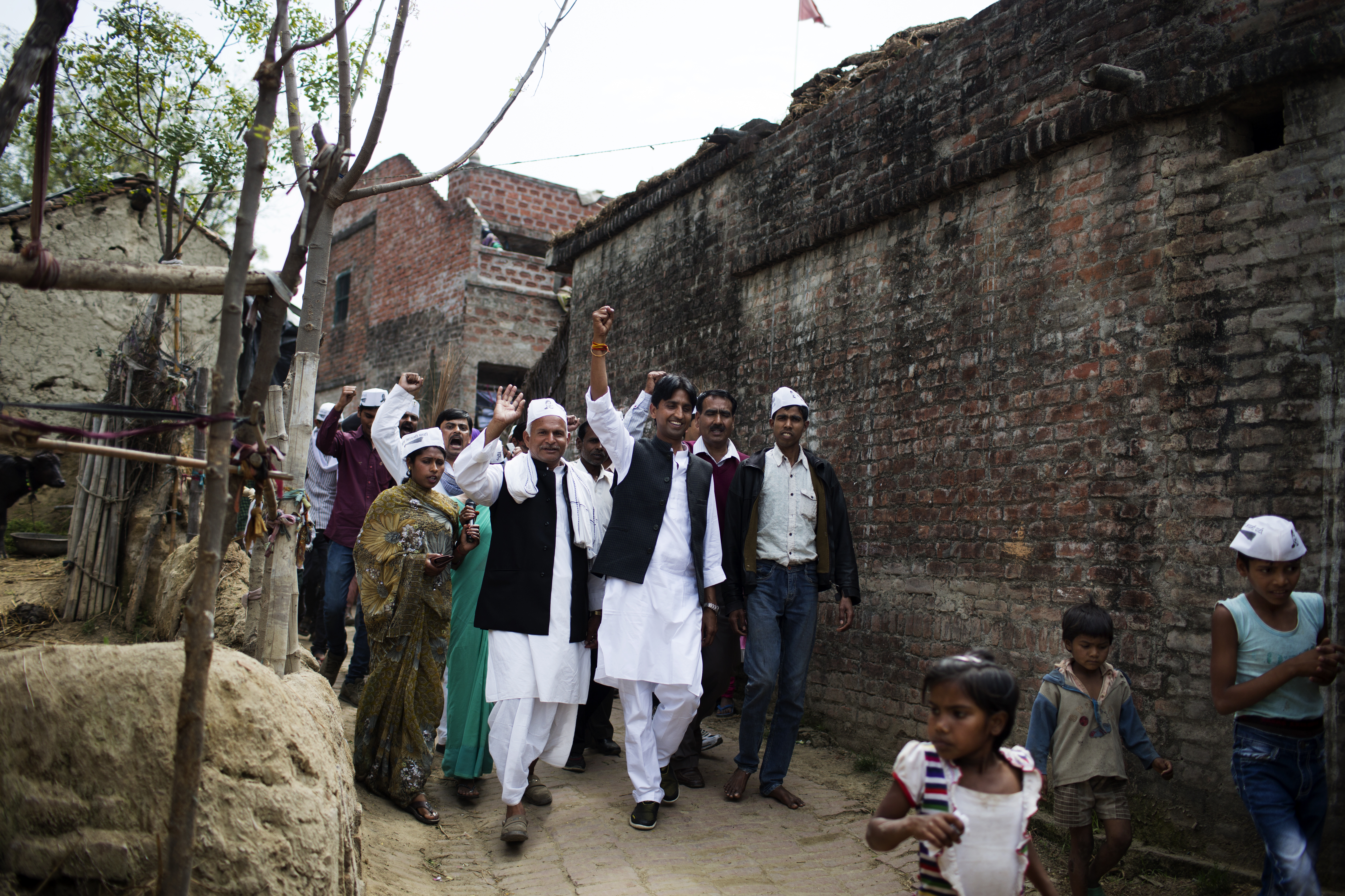AAP candidate Kumar Vishwas, front center, arm raised high, campaigns in Amethi district