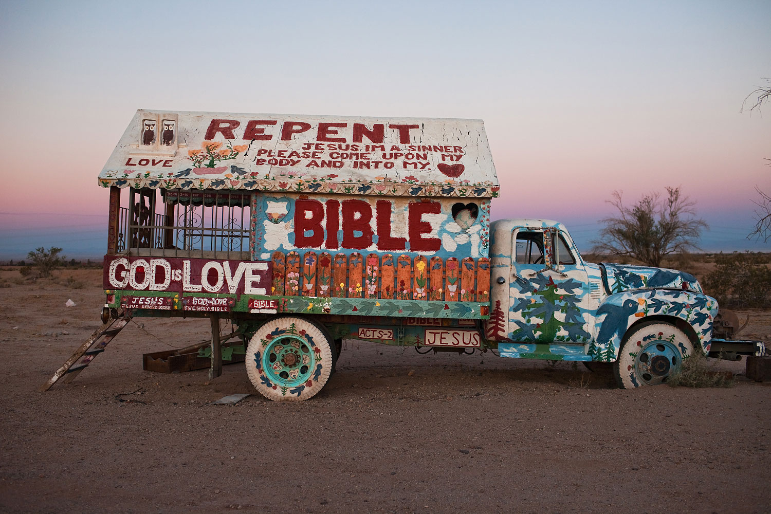 One of Knight's many art cars covered in scripture. He used to drive them in parades in the valley.