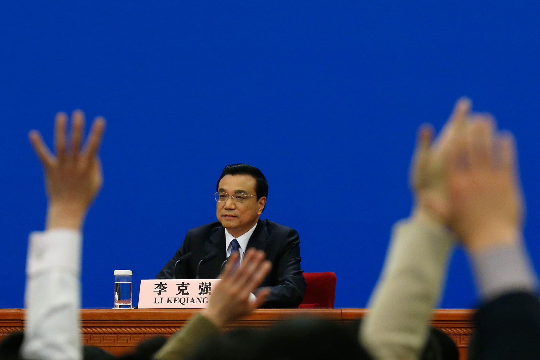 China's Premier Li Keqiang takes questions during a news conference, after the closing ceremony of the Chinese National People's Congress (NPC) at the Great Hall of the People, in Beijing March 13, 2014