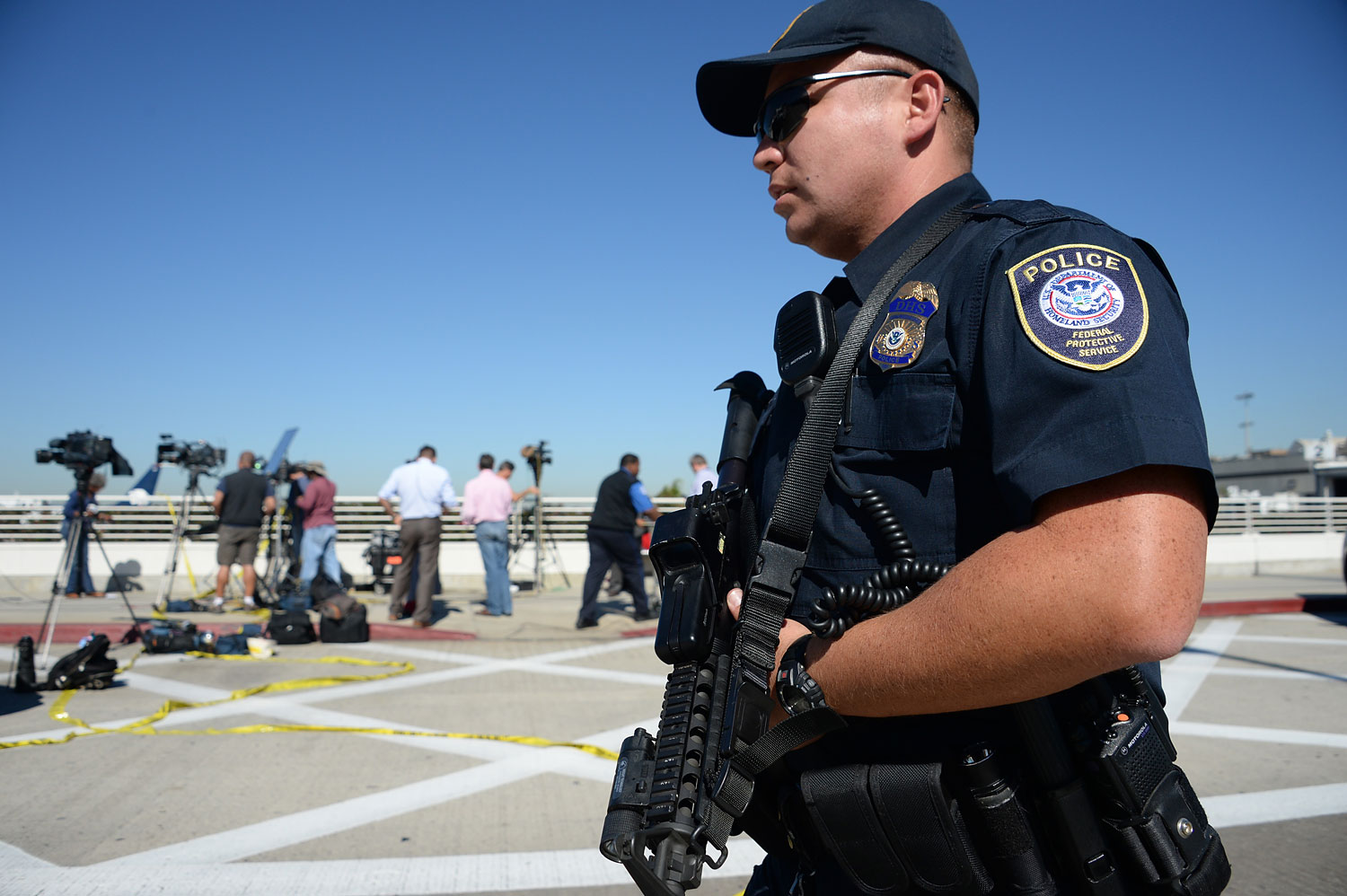 A policeman is positioned outside Terminal 3 at Los Angeles International Airport on November 1, 2013 after a gunman reportedly opened fire at a security checkpoint.