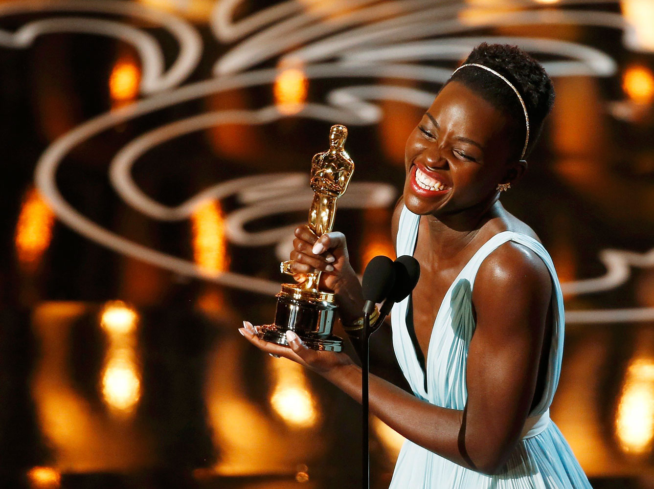 Lupita Nyong'o, best supporting actress winner for her role in  12 Years a Slave , speaks on stage at the 86th Academy Awards in Hollywood, California March 2, 2014.