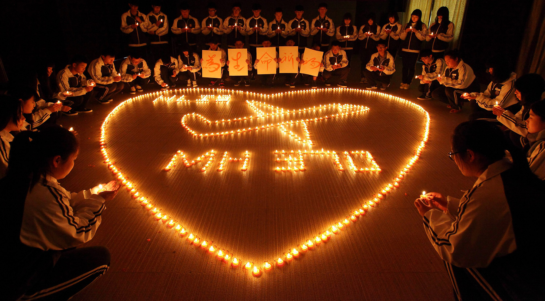 Students from an international school in the eastern Chinese city of Zhuji hold a candlelight vigil for the passengers on the missing Malaysia Airlines plane on March 10, 2014