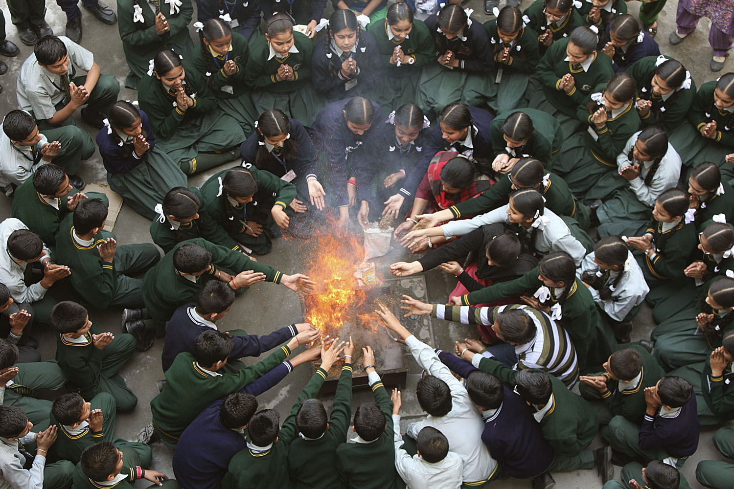 Mar. 25, 2014. Students attend a prayer ceremony in tribute to the passengers and crew onboard the missing Malaysia Airlines flight MH370 inside a school in Jammu. Bad weather and rough seas on Tuesday forced the suspension of the search for any wreckage.