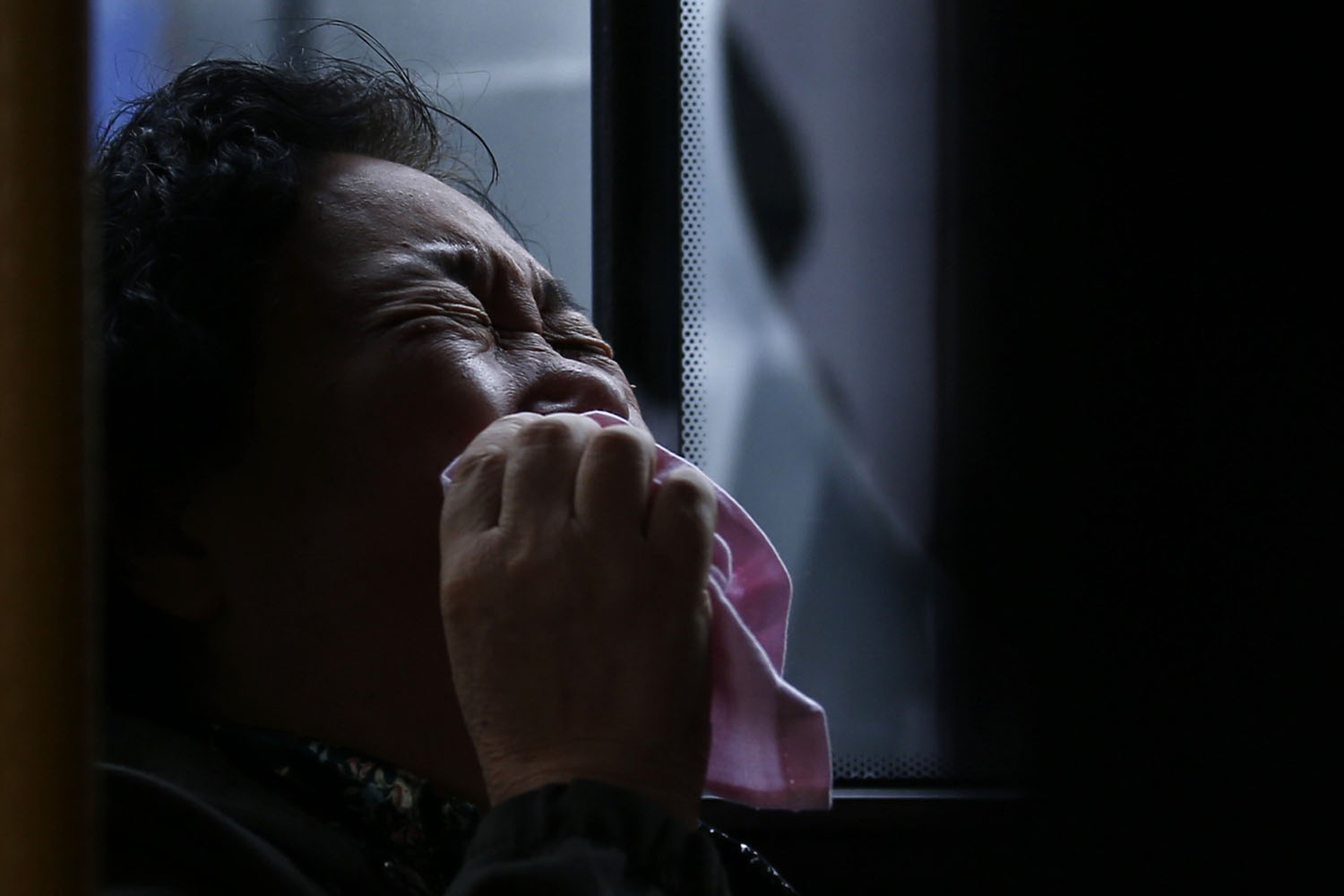 Mar. 25, 2014. A family member of a passenger onboard Malaysia Airlines Flight MH370 cries on a bus before heading to the Malaysian embassy, outside Lido Hotel in Beijing.