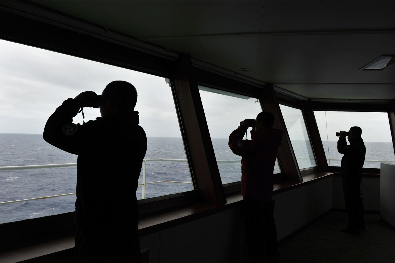 Mar. 23, 2014. Chinese Antarctic exploration team members aboard Chinese icebreaker Xuelong (Snow Dragon), search for missing Malaysian Airlines flight MH370 over the southern Indian Ocean.