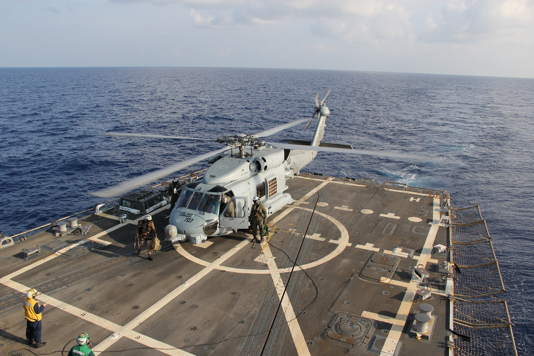 A U.S. Navy MH-60R Sea Hawk helicopter preparing to return to the search and rescue for the missing Malaysian airlines flight MH370 on March 9, 2014 at sea in the Gulf of Thailand.