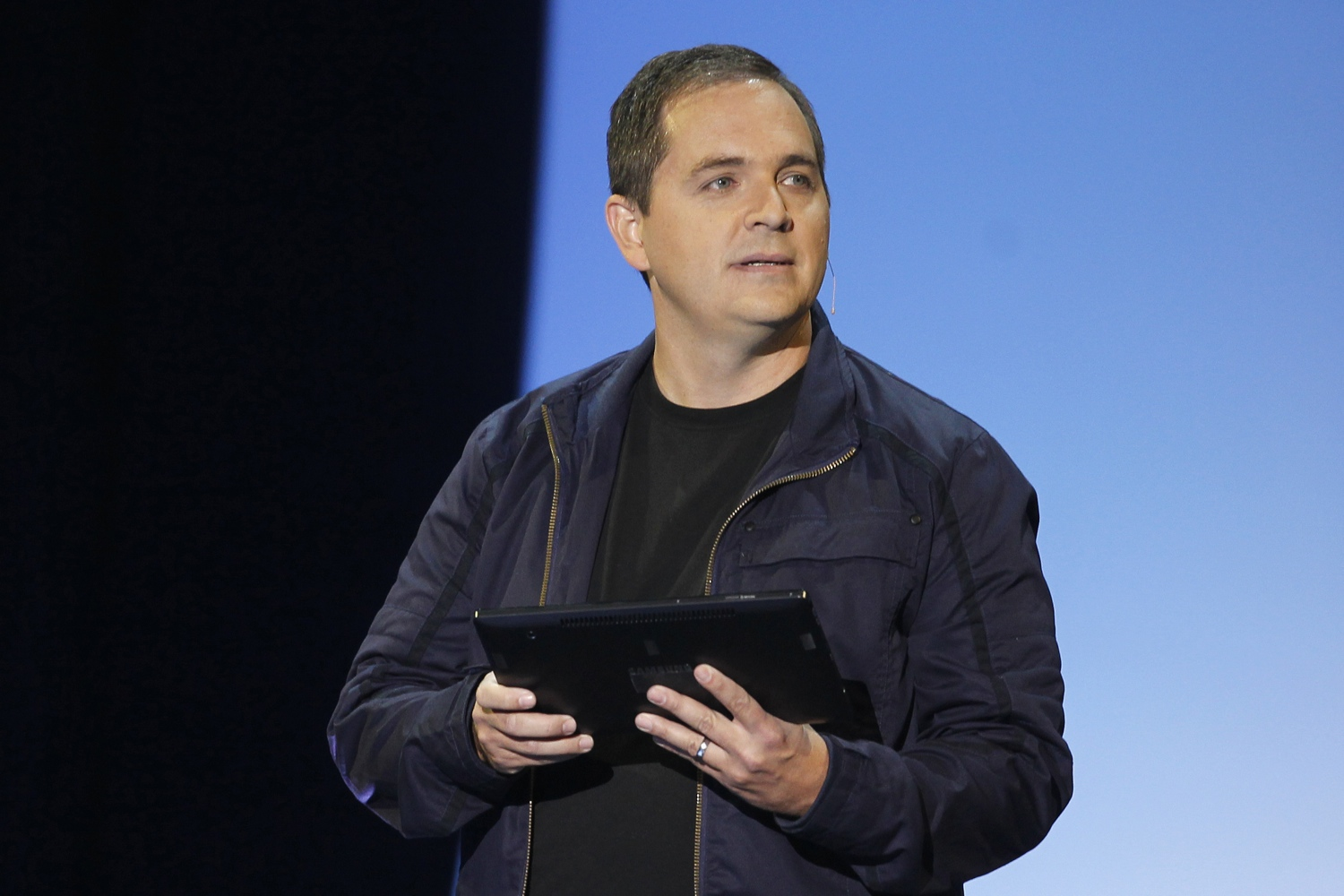 Marc Whitten, the head of Xbox Live, demonstrates the new Xbox feature, Xbox SmartGlass, a wireless tablet controller at the Microsoft Xbox news briefing during the E3 game expo in Los Angeles, California June 4, 2012.