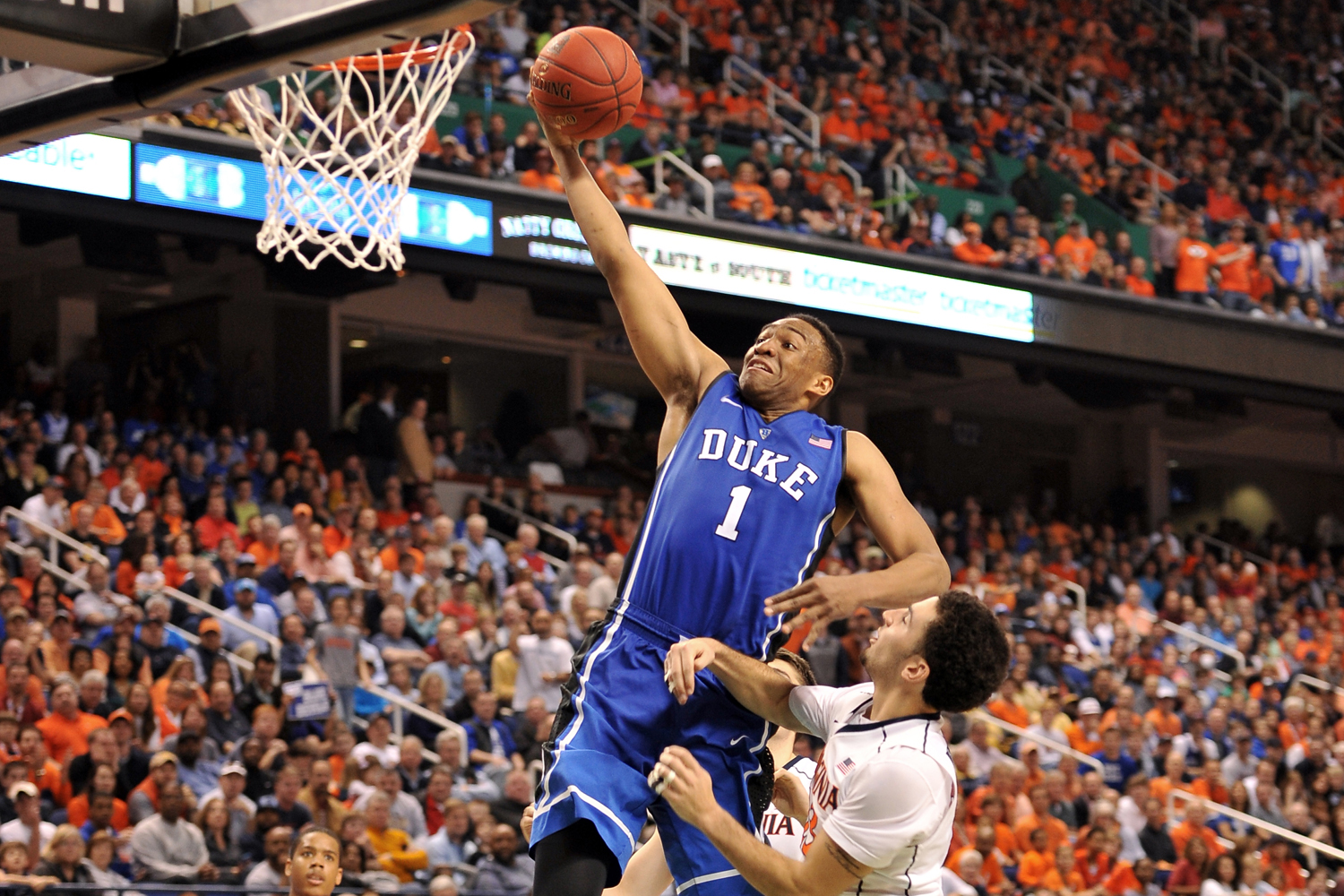 Jabari Parker, #1 of the Duke Blue Devils, goes up for a dunk against the Virginia Cavaliers during the finals of the 2014 Men's ACC Basketball Tournament on March 16, 2014 in Greensboro, North Carolina. Virginia defeated Duke 72-63.