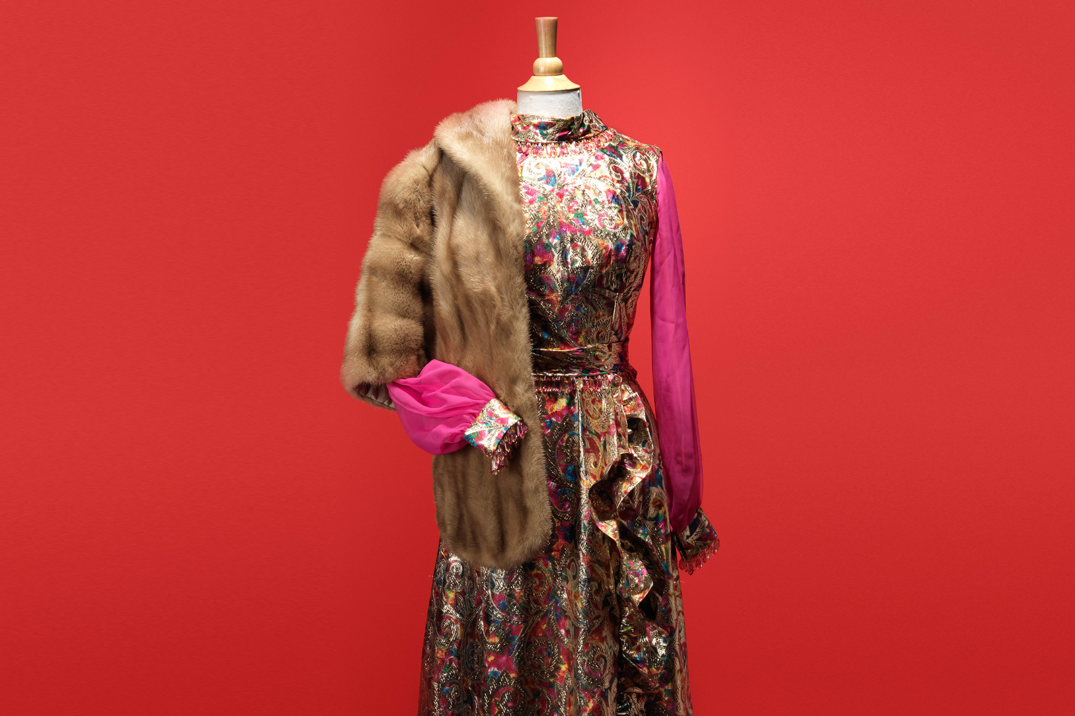 Megan's Andy Awards dress (1967, redesigned from tunic):  I wanted to show Megan's transformation to an actress, and the brocades really spoke to me … The Eastern influence was very fashion forward, and the [fur] stole is about that opulence. Also, Don used to work in the fur business.  —Janie Bryant, costume designer