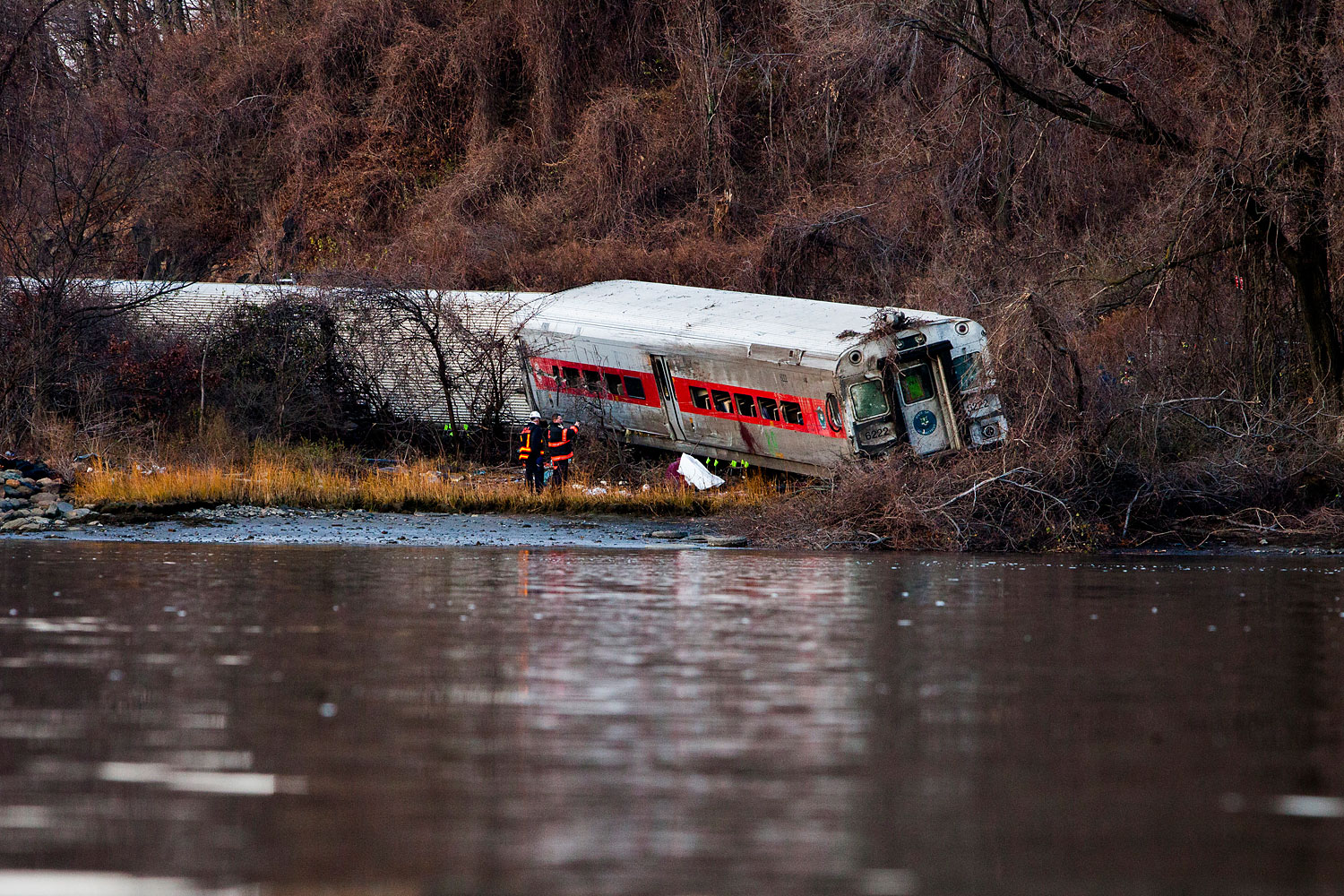 The wreckage of a Metro-North commuter train lies on its side after it derailed just north of the Spuyten Duyvil station December 1, 2013 in the Bronx borough of New York City.