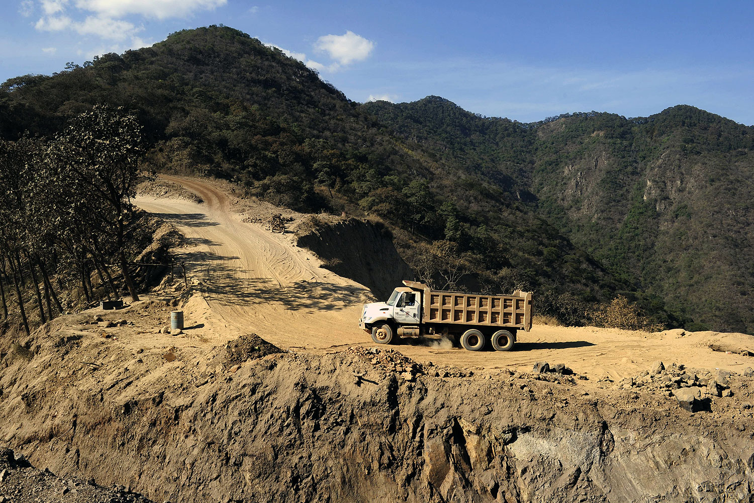 A truck clibs a road at a steel mine in the Aguililla community, in Michoacan State, Mexico, on Feb. 14, 2014