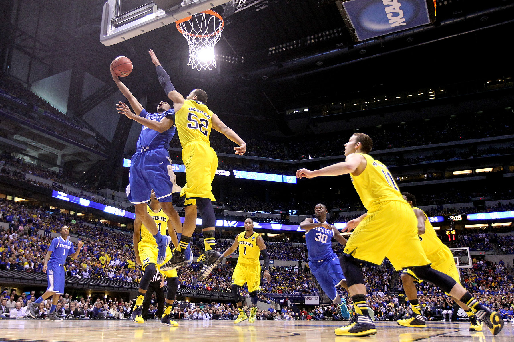 Marcus Lee of the Kentucky Wildcats shoots the ball against the Michigan Wolverines during the midwest regional final of the 2014 NCAA Men's Basketball Tournament at Lucas Oil Stadium on March 30, 2014 in Indianapolis, Indiana