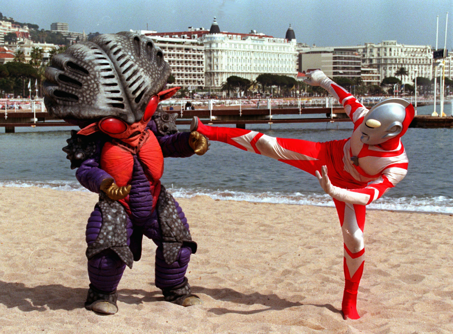 Japanese characters Ultraman, right, and Alien Benzene stage a fight on the French Riviera