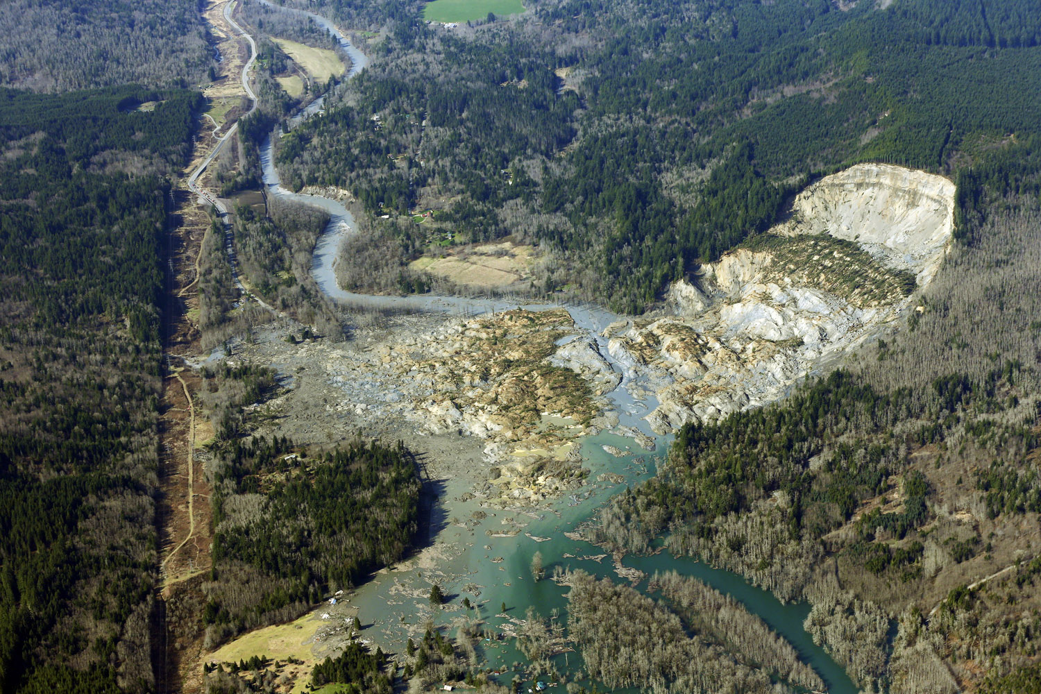 Mar. 24, 2014. An aerial photo of the massive mudslide that killed at least eight people and left dozens missing near Arlington, Wash.