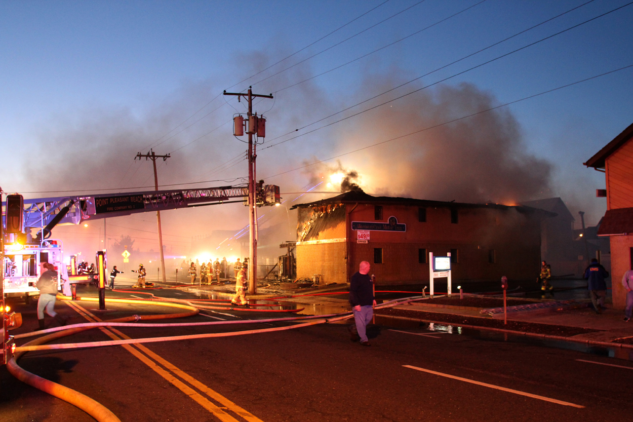 Firefighters work to put out a fire at  Mariner's Cove Inn  in Point Pleasant Beach, N.J., March 21, 2014.