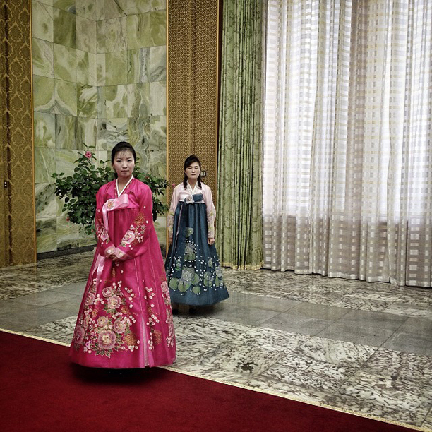 Inside Pyongyang's Masudae Assembly Hall two women wait to lead us down a red carpet to meet Kim Yong Nam, the head of the Presidium of the Supreme People's Assembly of North Korea, April 10, 2013.