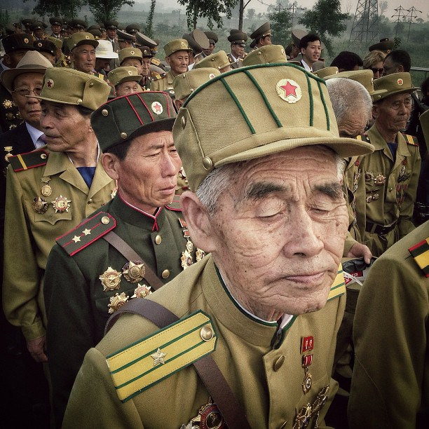 Korean War veterans enter a cemetery for their deceased fellow war veterans in Pyongyang, July 24, 2013.