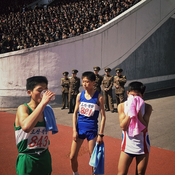 North Korean runners rest at the finish line of the 26th Mangyongdae Prize Marathon in Pyongyang, Kim Il-Sung Stadium, April 14, 2013.