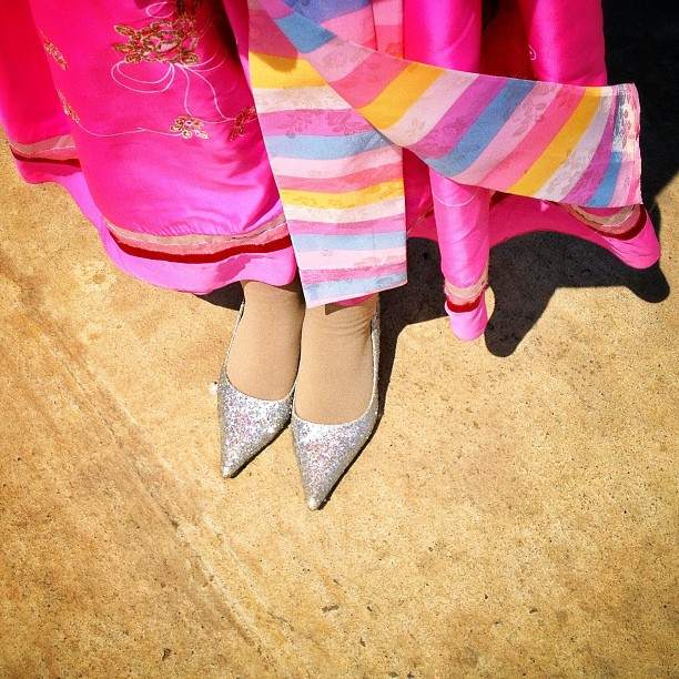 Glittery silver heels and a traditional dress as colorful as an Easter egg, Pyongyang, April 10, 2013.