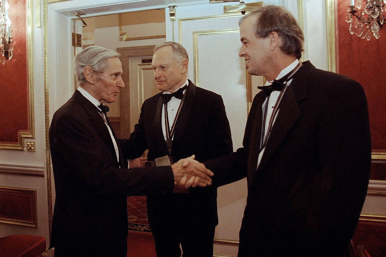 In this Nov. 16, 1994, file photo, The National Book Awards prize winning writers Sherwin B. Nuland, center, William Gaddis, left, and James Tate greet each other after the awards ceremony in New York. Nuland, has died at age 83