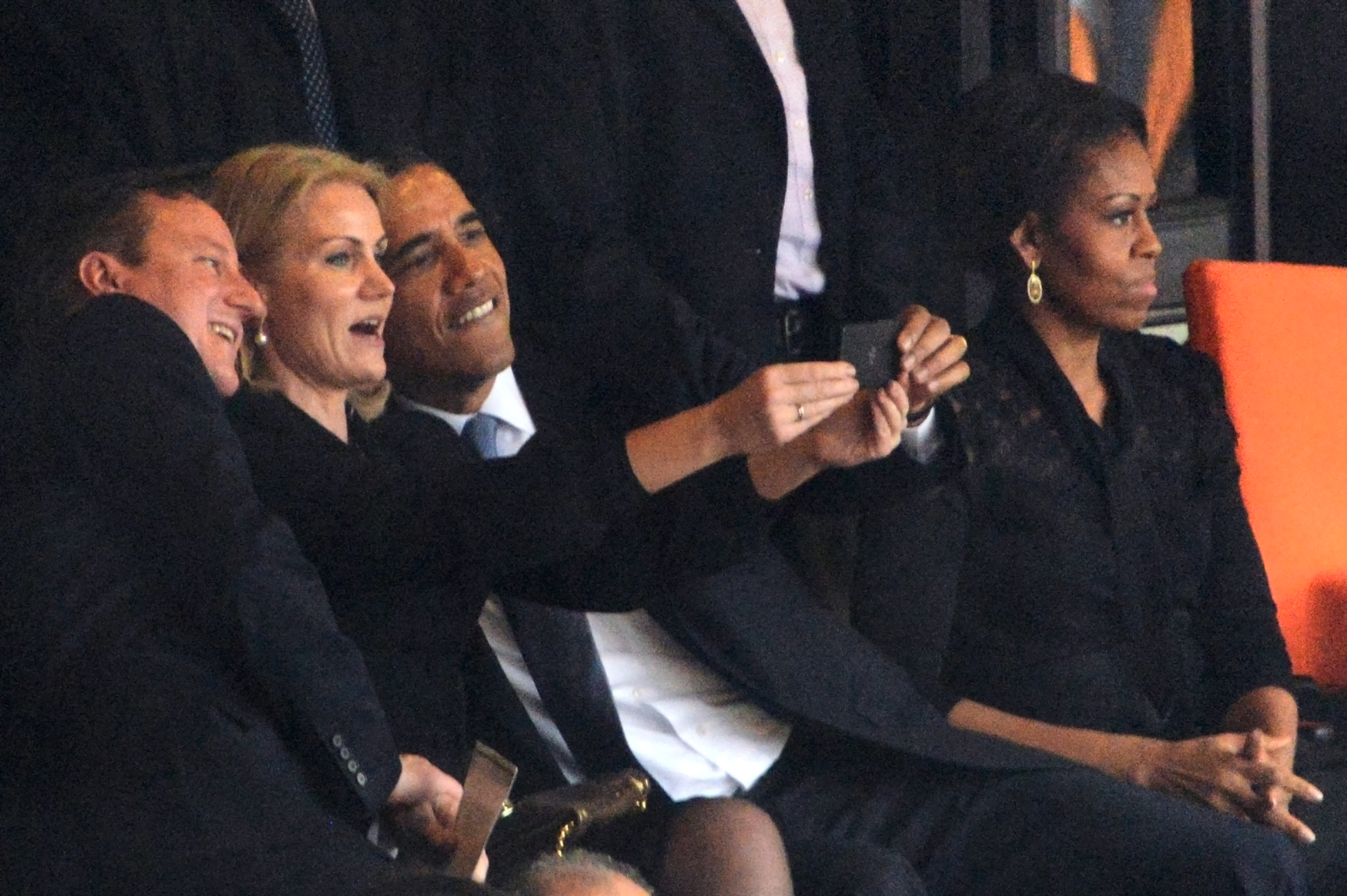U.S. President  Barack Obama and British Prime Minister David Cameron pose for a selfie with Denmark's Prime Minister Helle Thorning Schmidt during the memorial service of former South African president Nelson Mandela in Johannesburg, Dec. 10, 2013.