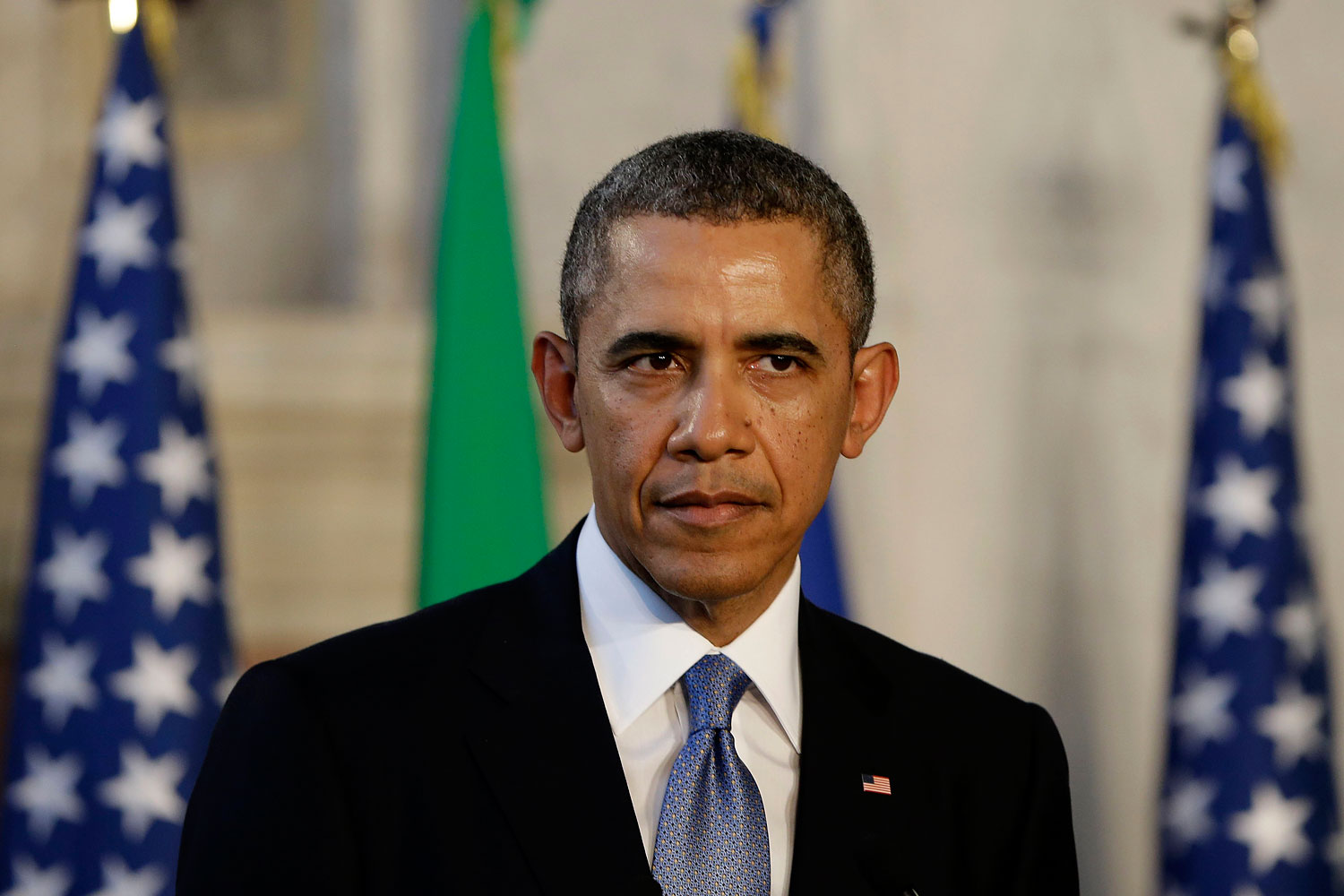 President Barack Obama listens during a joint news conference with Italian Prime Minister Matteo Renzi, Thursday, March 27, 2014, at Villa Madama in Rome. (AP Photo/Pablo Martinez Monsivais)