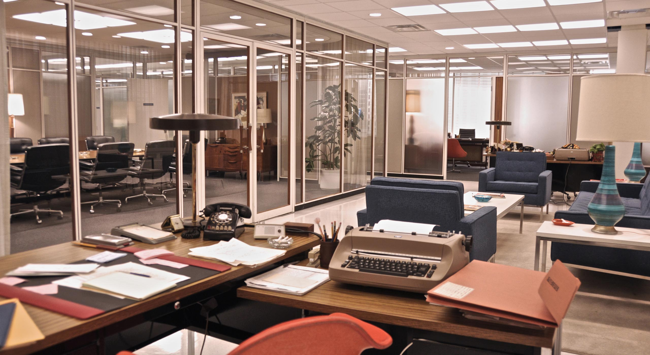 Sterling, Cooper & Partners office (1964, inspired by New York City's Lever House):  The old office was more about wood and mid-tones and was really designed in the '50s. In the '60s, people move towards primary colors and bolder graphics. Those stronger colors reflect well against a white background.  —Dan Bishop