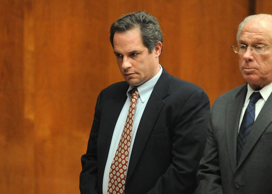 Thomas Rica, a former Ridgewood borough employee, stands with his attorney Robert Galantucci, during a hearing at the Bergen County Courthouse Wednesday, March 19, 2014, in Hackensack, N.J.
