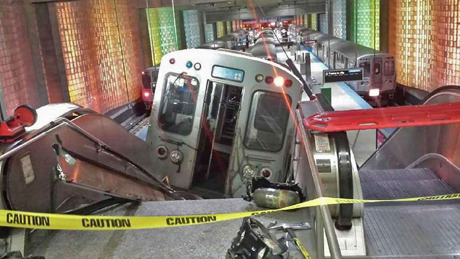 A derailed commuter train is shown resting on an escalator at O'Hare international airport in Chicago March 24, 2014.