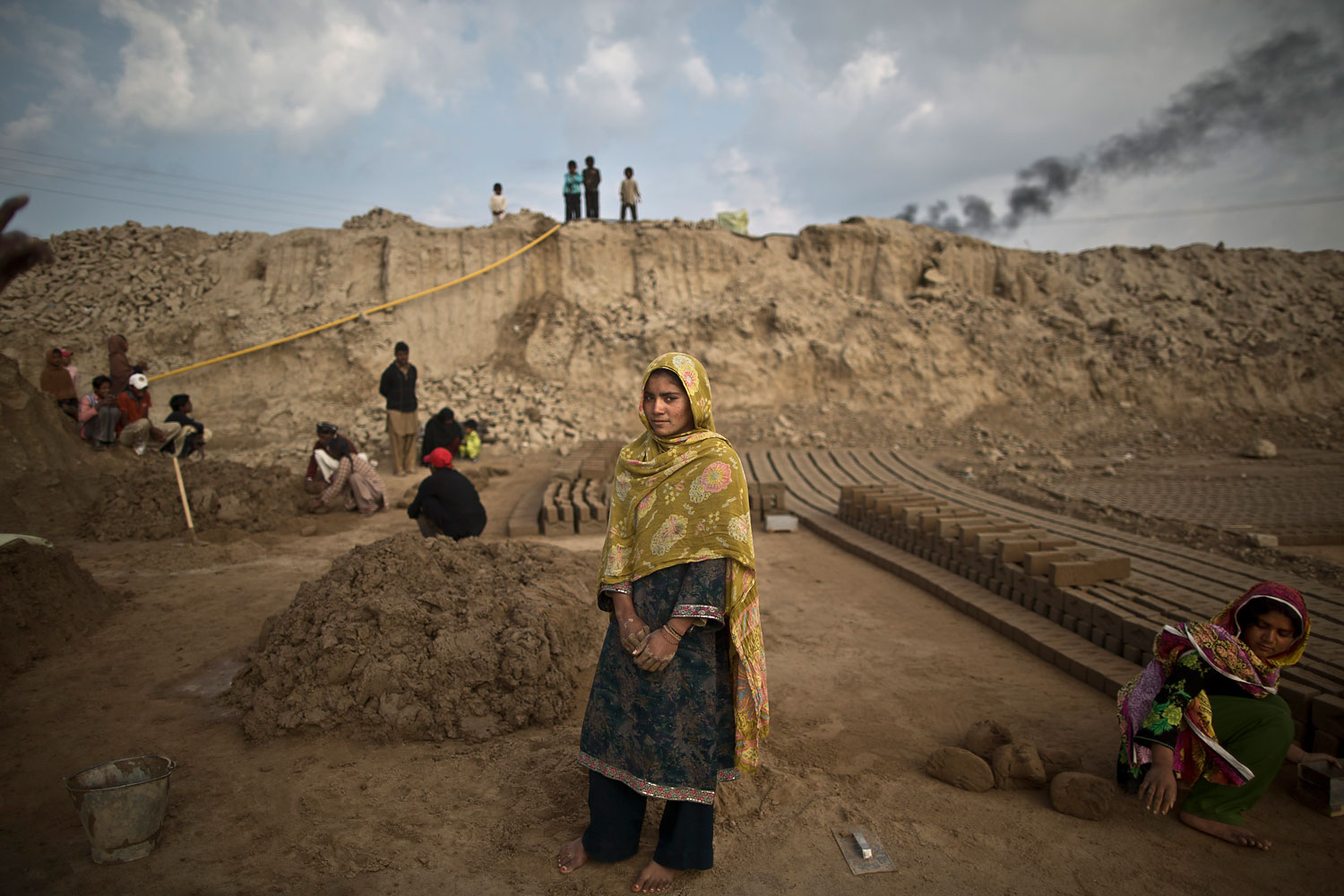 Navila Shirali, 17, a Pakistani brick factory worker, poses for a picture at the site of her work in Mandra, near Rawalpindi, Pakistan, March 5, 2014. Navila's father is in debt to his employer the amount of 500,000 rupees (approximately $5000).