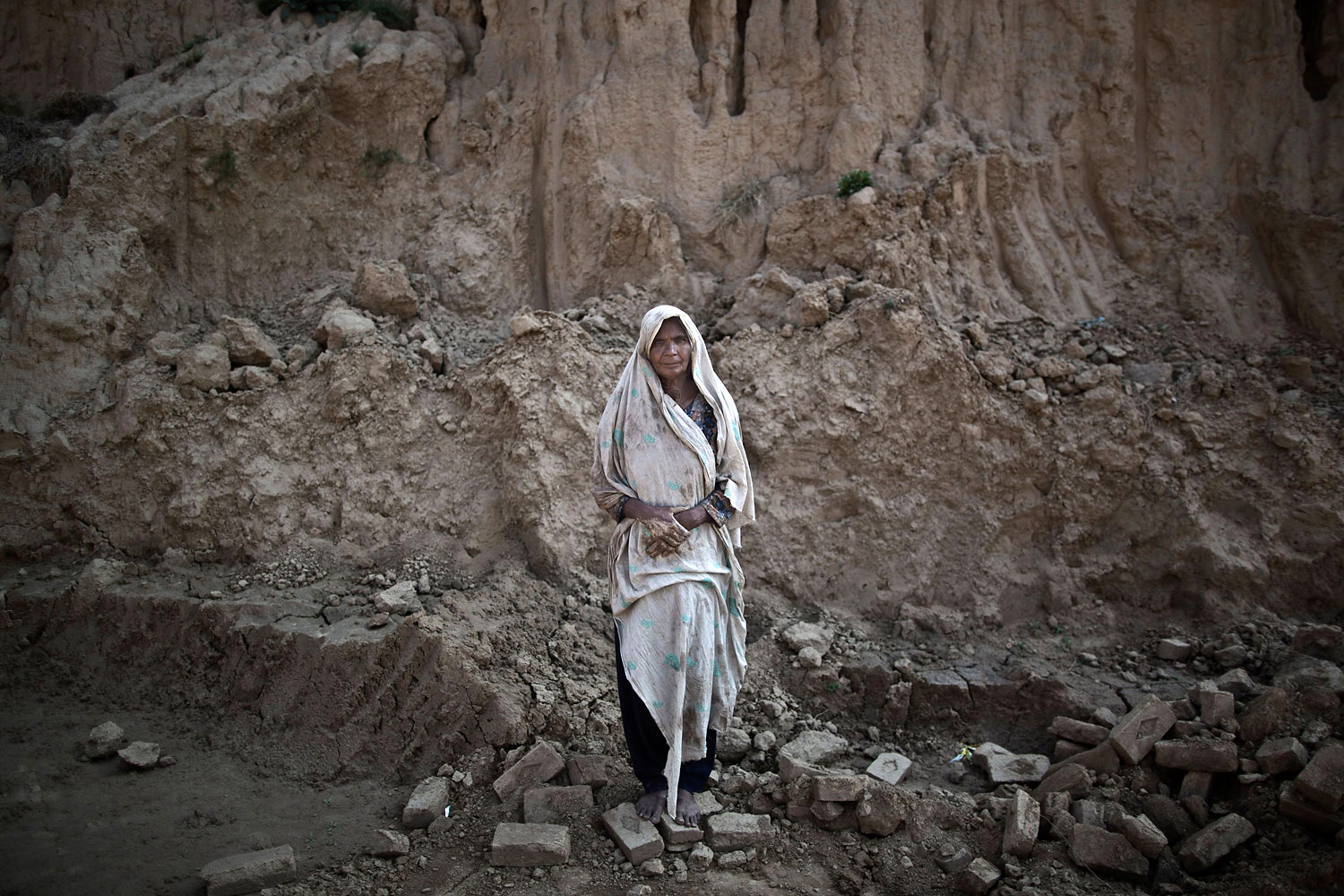 Amna Bhatti, 60, a Pakistani brick factory worker, poses for a picture at the site of her work in Mandra, near Rawalpindi, Pakistan, March 2, 2014. Amna is in debt to her employer the amount of 150,000 rupees (approximately $1,500).