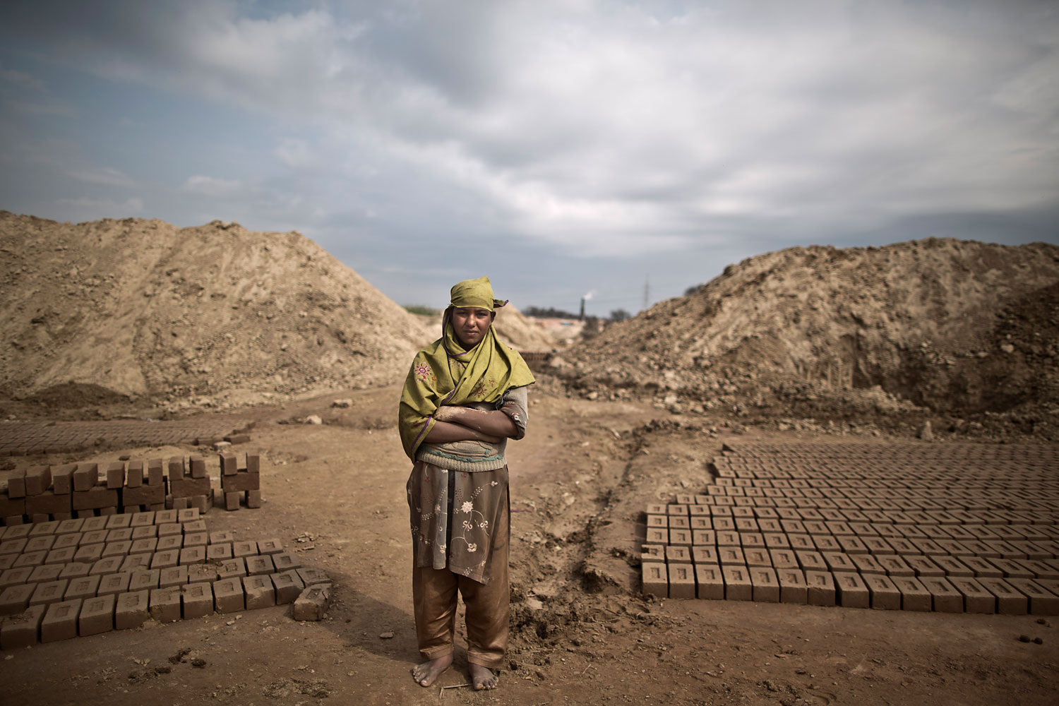 Naila Liyaqat, 16, a Pakistani brick factory worker, poses for a picture at the site of her work in Mandra, near Rawalpindi, Pakistan, March 5, 2014. Naila's father is in debt to his employer the amount of 300,000 rupees (approximately $3000).