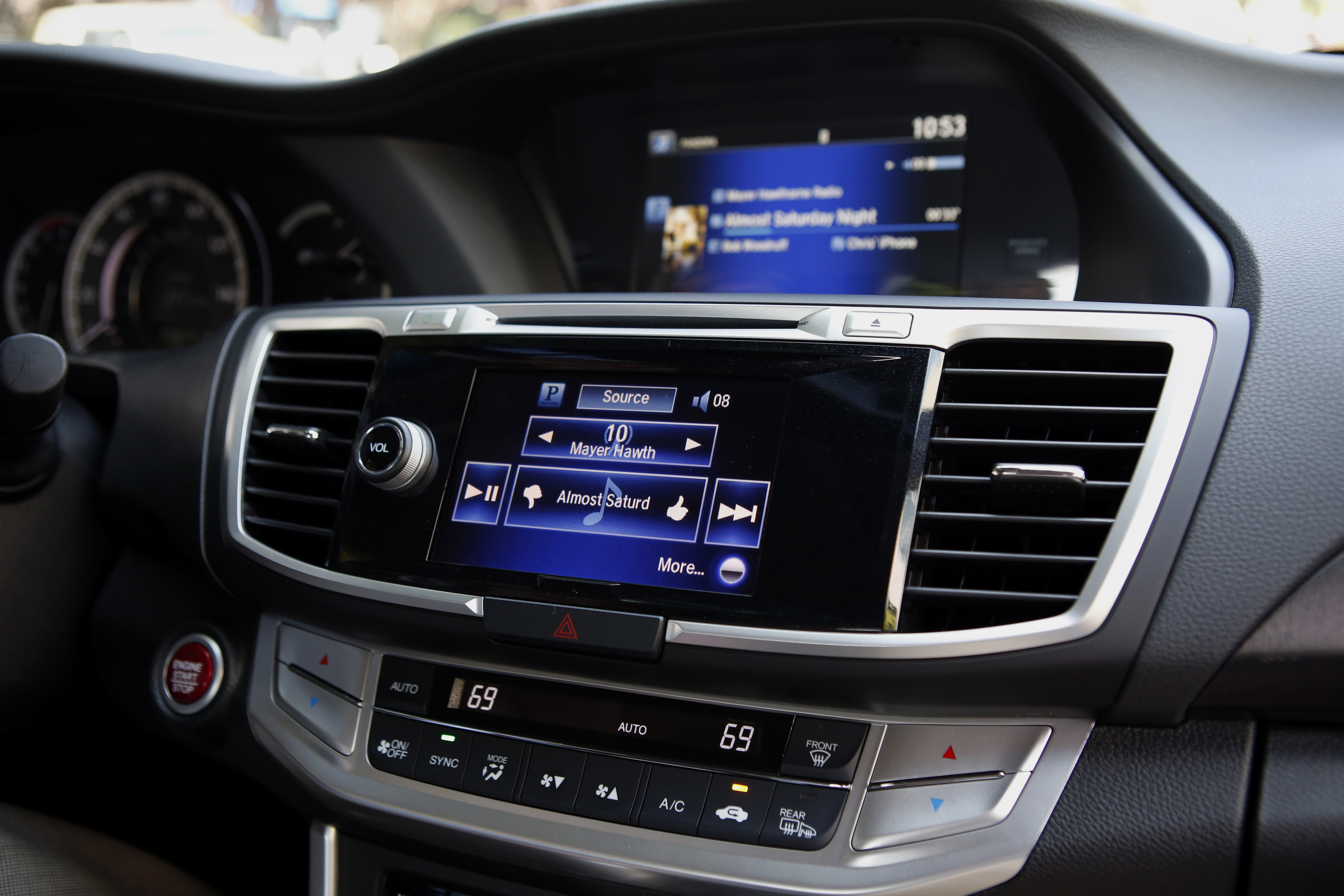 The Pandora integrated entertainment system is demonstrated inside a Honda Accord.