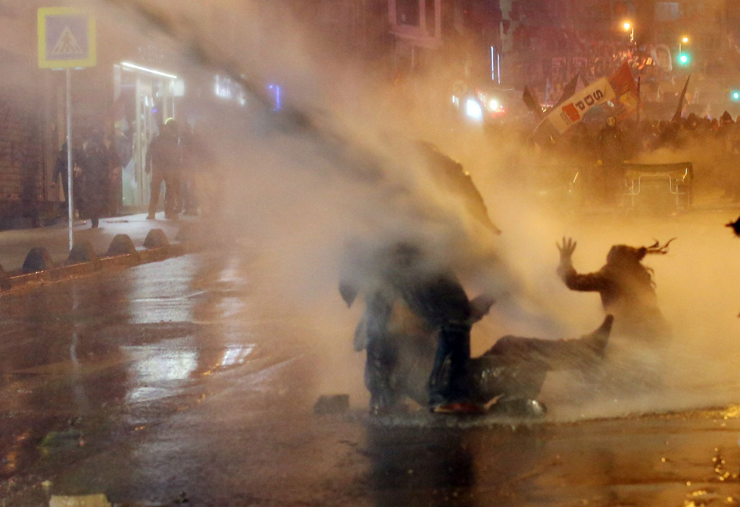 Protesters are hit by water cannon during clashes with riot police in Kadikoy, on the Anatolian side of Istanbul, on March 11, 2014.