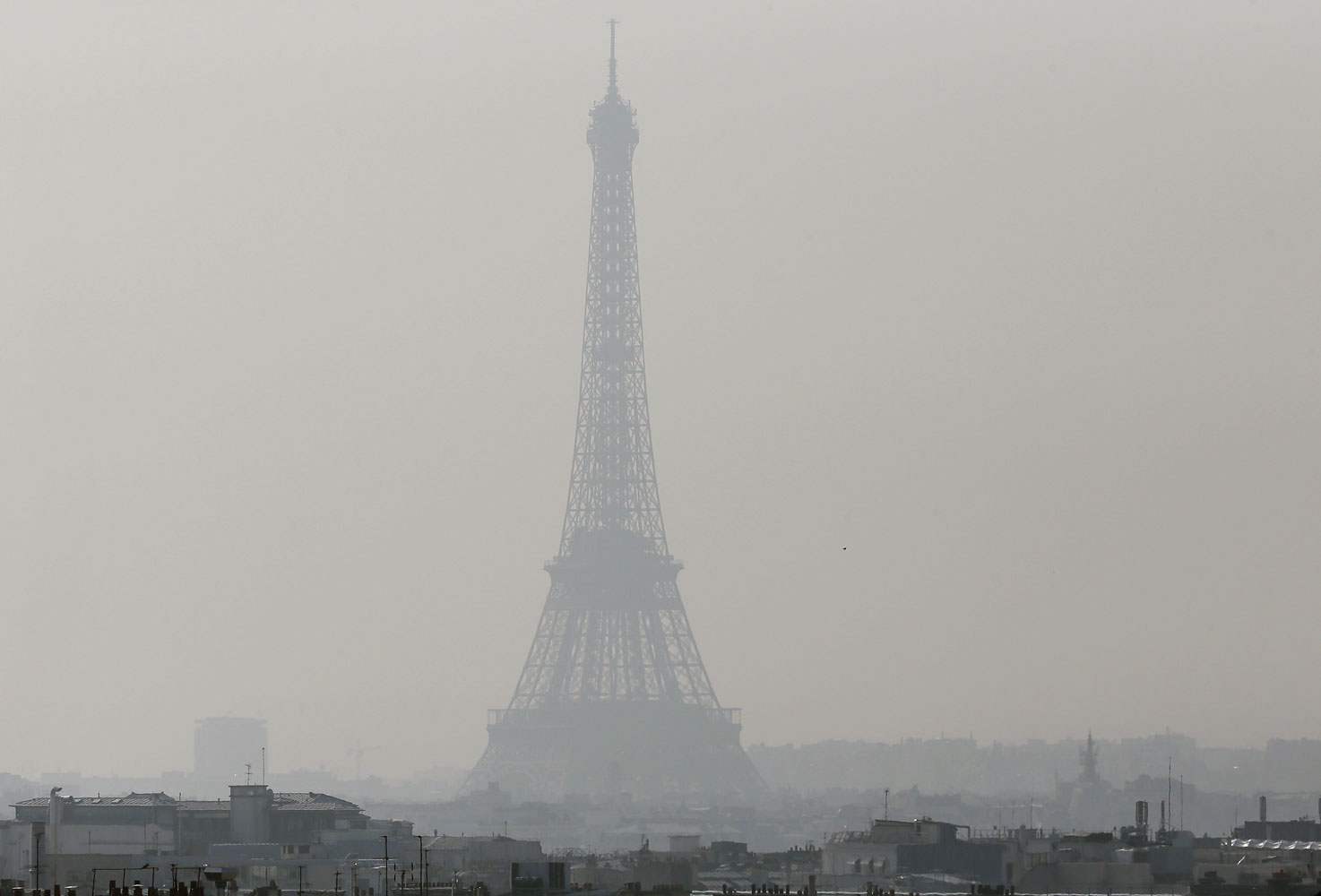 A view of the Eiffel Tower seen through thick smog, on March 14, 2014, in Paris.